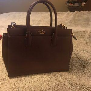 Burgundy Kate Spade large hand bag.